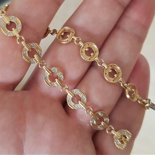 Armlænke i Moderne Design 14 Karat Guld m. i alt 0,25 carat Diamanter.