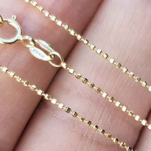 Facet Slebet Guld Halskæde i Kugle Design.