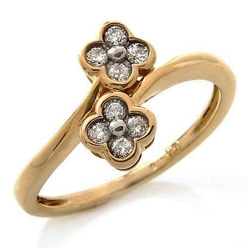 Blomst/Roset Ring i Guld m. Diamanter.