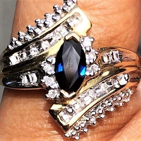 Guld Ring m. Marquise Slebet Safir og Diamanter.